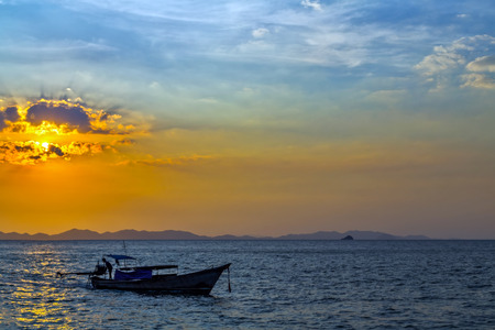 sunrise longtail boat with rock islands on horizon . Thailand Seascape andaman sea. Tourism travel sunrise