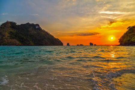 sunrise paradise evening island. Beauty Scene or sun over colorful sky with clouds Seascape tropical nature background Stock Photo