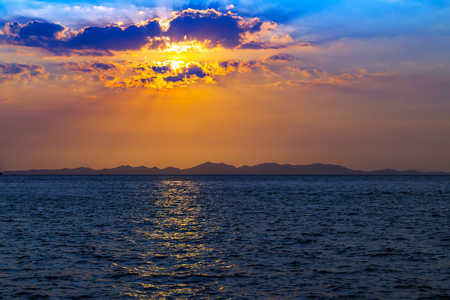 Sea Sunset Beach, paradise evening mountains island. Beauty Scene or sun over colorful sky with clouds Seascape. Tourism travel, vacation concept tropical nature background