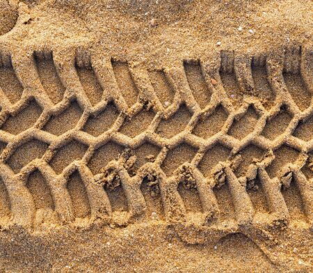 traction: off-road automobile trace tyre desert sand background