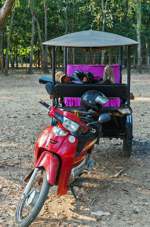 rickshaw: Siem Reap, Cambodia - 25 FEB, 2015: Asian rickshaw with no people in passes Taxi in Cambodia Tuk Tuk of Angkor Wat, Khmer temple complex, Asia.