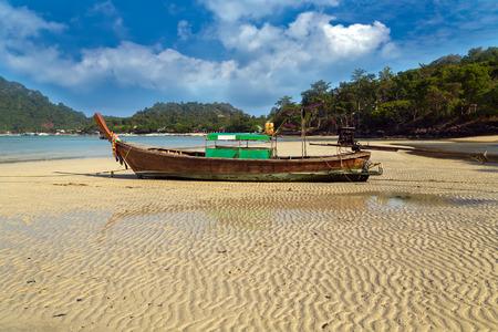 Traditional thai old boats on sand beach island Thailand