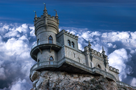 alupka: The castle Swallows nest. The village of Gaspra on the Crimean background of the cloudy sky, Top of the 40-metre (130 ft) high Aurora Cliff, in a Neo-Gothic design.
