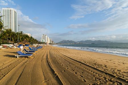 Deckchairs, umbrella and chair, parasol on the tropical sand beach
