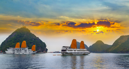 Sunset over Ha Long bay islands Halong mountains in South China Sea, Vietnam.