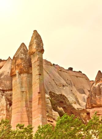 Love valley needles striped, Volcanic tuff named phallic rock pillar. Rocky landscape of Cappadocia in Turkey Stock Photo
