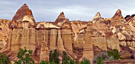 Love valley needles striped, Volcanic tuff named phallic rock pillar. Rocky landscape of Cappadocia in Turkey, Aerial photography.