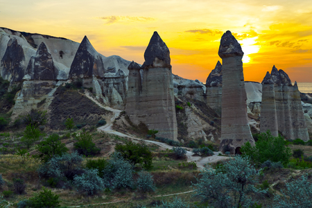 Rising Sun Love valley 'willy shaped' rocks, mountain landscape in Cappadocia, Turkey. The rock formations are a result of volcanic eruptions in ancient times.