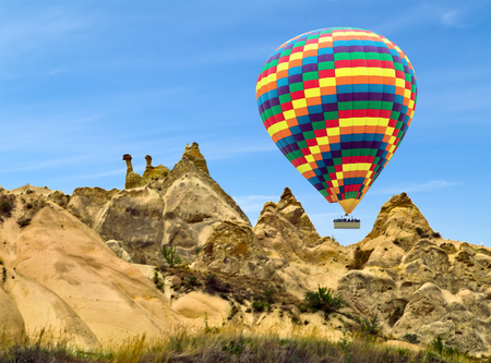 Hot air balloons flying in sunset Volcanic rock formations in Cappadocia, Anatolia, Turkey. Travel background