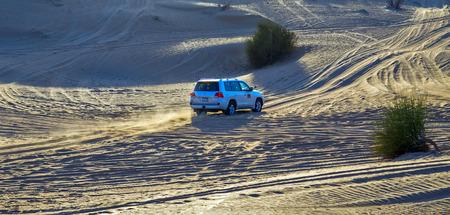 DUBAI, UNITED ARAB EMIRATES - JANUARY 25, 2016: Safari Toyota rally off-road car 4x4 adventure driving in the desert sand dune is a popular activity among tourists in Dubai.