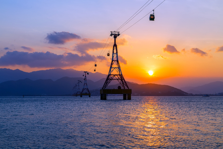 Cable car eiffel tower to Vin pearl Amusement Park Island Scenic Colorful Sky At Sunset Dawn Sunrise, cableway long rope road on water bay Nha Trang, Vietnam Stock Photo