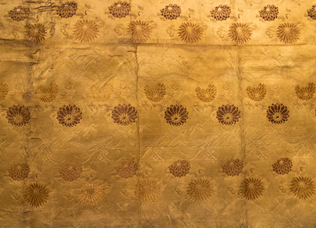Vintage traditional japanese silk gold kimono Japan pattern on decorative background.