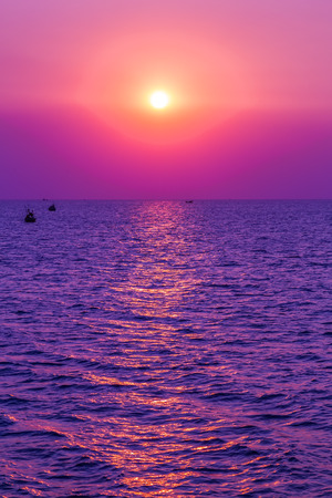 Sunrise Sun purple and pink sky with reflection in water, colorful clouds wallpaper