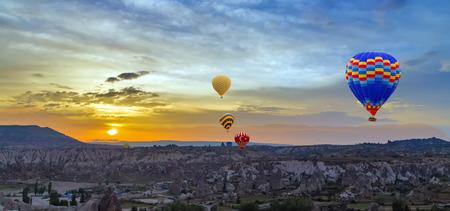 Hot air balloons sunset discovery Cappadocia, Anatolia, Turkey. Open air museum, Goreme national park. Stock Photo