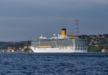 Cruises ocean liner sailing in to Bosphorus Strait that separates the Black Sea and the Sea of Marmara, Istanbul, Turkey. Stock Photo