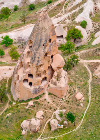Cave towns in rock formation, Stone houses in Goreme, mountain landscape carved in volcanic tuff Cappadocia, Anatolia, Turkey. Open air museum