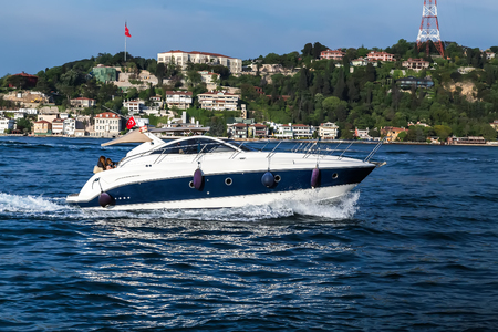 Tourist passenger motor boat on the Bosphorus strait, Sea front landscape of Istanbul historical part, Turkey famous city.