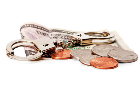 coin money and handcuffs Criminal isolated on white background Stock Photo