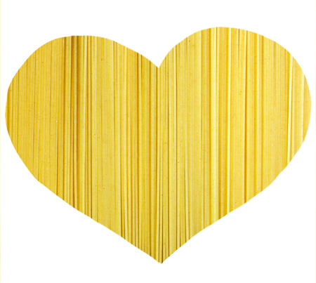 Decorative heart texture spaghetti pasta isolated on white background Stock Photo