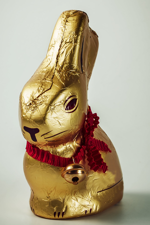 Gold chocolate hare Easter Bunny vintage background.