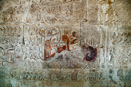 Khmer relief carving of gods fighting demons. Inner wall of the temple of Angkor Wat, Siem Reap, Cambodia.
