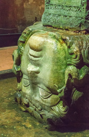 Block carved with the visage of Medusa head pillar. Basilica Cistern the city of Istanbul, Turkey.