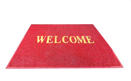 Red welcome carpet, mat threshold doormat isolated on white background Stock Photo