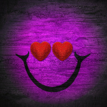 smile in purple black wall wood texture background Фото со стока