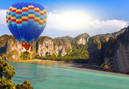 sun hot air balloon landing in a mountain jungle island sea landscape Stock fotó