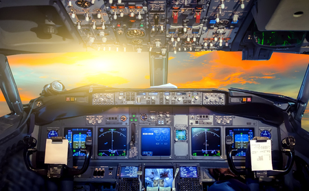 Sunrise tropical sky cloud airplane cockpit Flight Deck 版權商用圖片