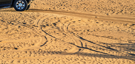 Safari extreme rally off-road car 4x4 adventure driving in the desert sand dune is a popular activity among tourists in Dubai.