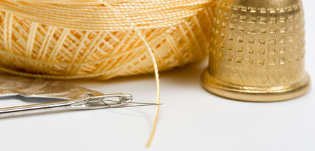 Thread needle button Thimble metal for sewing Stock Photo