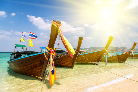 Spring sunset Thai boat in island bay - travel tropical south of Thailand