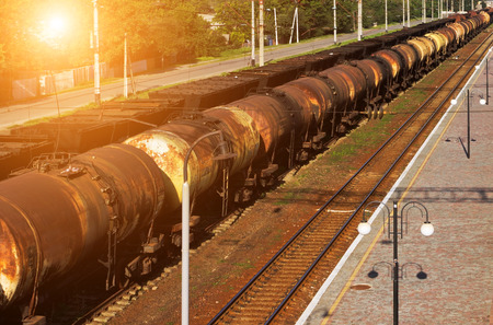 Oil transportation train of the tank, transportation railway tanks with oil and fuel old wagon. Stock Photo