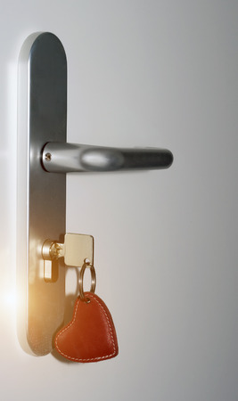 key in keyhole door handle, lock with your keys on an armored door. Security hotel doors concept Key of my heart valentines day