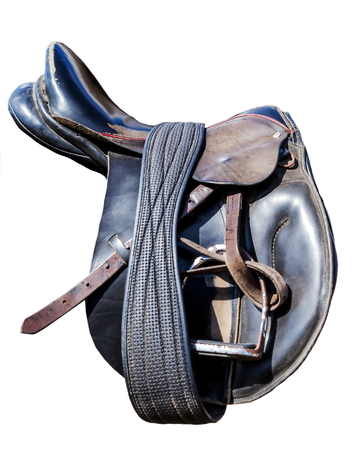 Leather Old Saddles horse with stirrups on a back of a fence