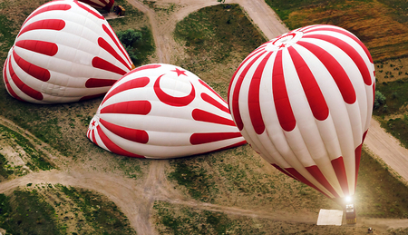 Balloons Turkish flag, Cappadocia Hot Air Balloon Flight Tour. Goreme National Park. Turkey.