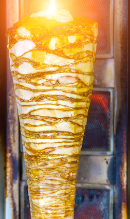 Istanbul street food Doner Kebab made of meat cooked on a vertical rotisserie. traditional Turkish dish Shawarma meat grilled that is eaten throughout Turkey Food.