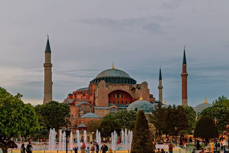 Istanbul, Turkey – April 30, 2014: Istanbul landscape Hagia Sophia Museum architecture domes and minarets in the old town view from park at the Sultanahmet area. Istanbul, Turkey