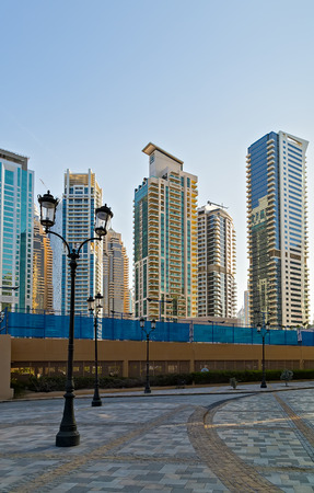 DUBAI, UAE - January 24, 2016: Dubai skyline towers Skyscrapers architecture of a Persian Gulf shoreline Dubai, United Arab Emirates. Sajtókép