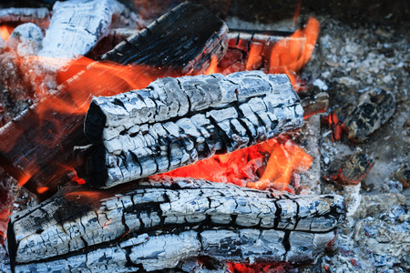 Burning firewood. charcoal burning ready to barbecue grill closeup fireplace. Heat from the fire Campfire.