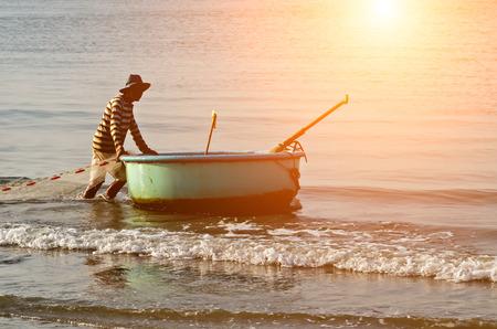 Fisherman Vietnamese fishing basket boats on the beach Vietnamese fishing village, Mui Ne, Vietnam