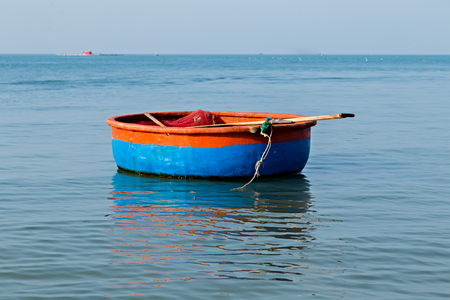 Fisherman Vietnamese fishing Blue red basket boats on the beach Vietnam