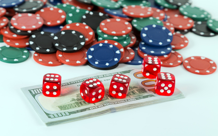 Casino red dices on gaming table US Dollar bills casino poker chips isolated on white background