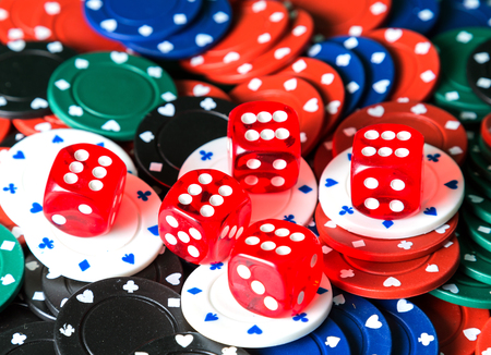 Casino red dices Close up on casino poker chips background