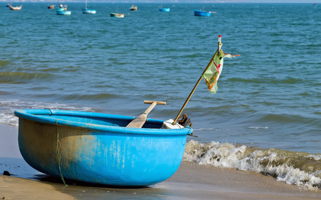 Fisherman Vietnamese fishing basket boats on the beach sea landscape Vietnam