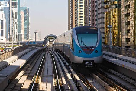 DUBAI, UAE - January 24, 2016: Dubai Metro Network line on the urban landscape Frame building architecture UAE, architecture with subway monorail train automated.