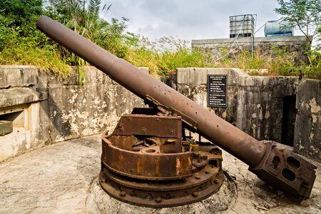 Cat Ba Island, Lan Ha Bay, Vietnam - November 30, 2014: Artillery gun 138 mm Cannon Fort. The Japanese built tunnels and gun posts World War II, French during the Indochina War, Viet Cong during the V