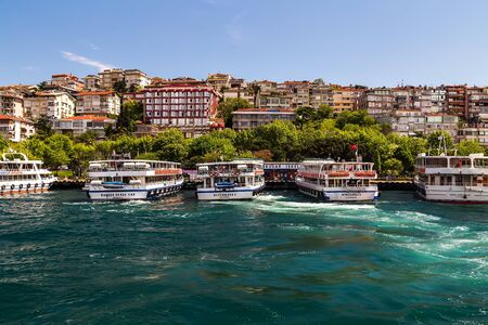 Istanbul, Turkey - May 02, 2014: Ferry passenger boat on the Gulf Golden Horn, Channel Bosphorus Strait Sea front landscape of Istanbul tourist city. Редакционное