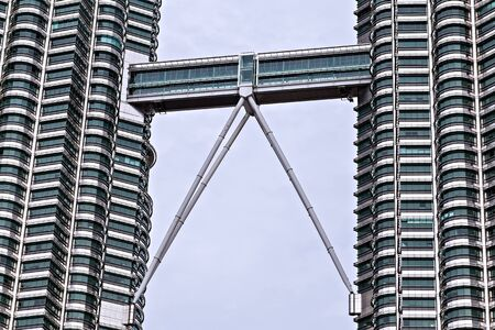 KUALA LUMPUR - February 19, 2015: A skybridge connects the two towers observation deck of Petronas Twin Towers KL Tower landmark of Kuala Lumpur located in Malaysia KL